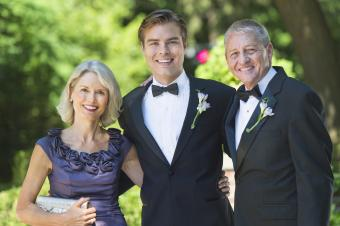 Groom with parents at wedding