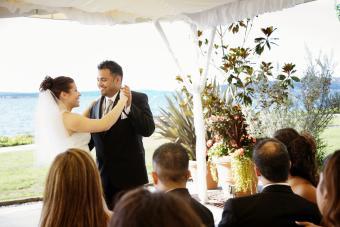 Multi-ethnic bride and groom dancing