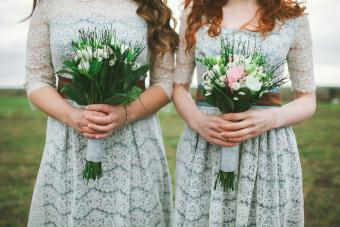 Bridesmaids holding a bouquet of flowers