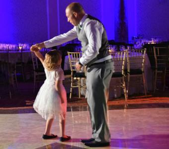 flower girl dancing with dad
