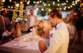 couple kissing during wedding reception
