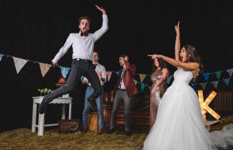 Surprised bride looking at man