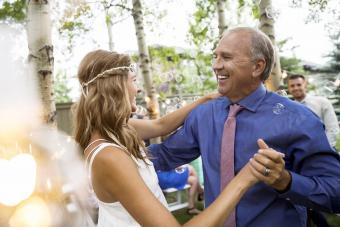 Bride and father dancing at backyard wedding reception