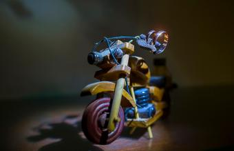 Wedding rings on a toy wooden motorcycle