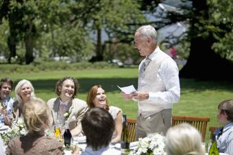 Father toasting couple at wedding
