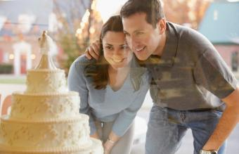 Couple window shopping for wedding cakes