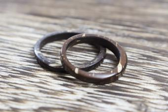 Unique pair of handmade coconut rings in wooden background