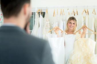 Man choosing wedding dress
