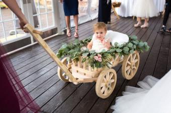 wedding wagon with young flower girl