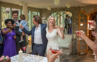 newlyweds toasting at reception
