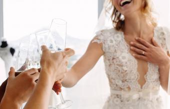 bride toasting with bridal party