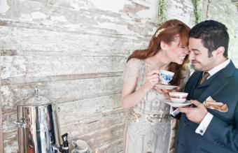 Elegantly dressed couple at barn wedding