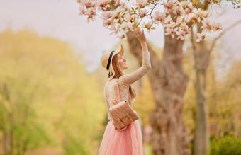 Woman in a dress in a spring garden