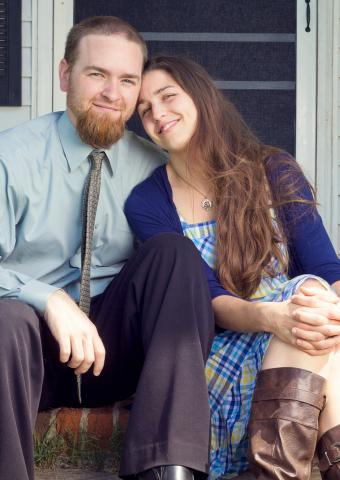 Couple dressed for a barn wedding