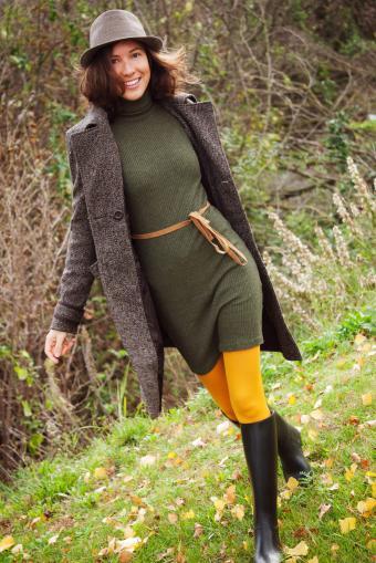 Woman wearing a warm knit dress and coat