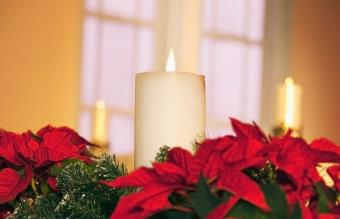 Poinsettias and candles lit