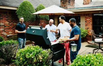 Laughing friends barbecuing