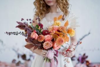 Bride with colorful autumn bouquet