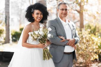 father and daughter walking down aisle at wedding