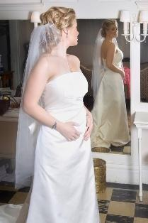 A bride trying on a semi-form fitting gown