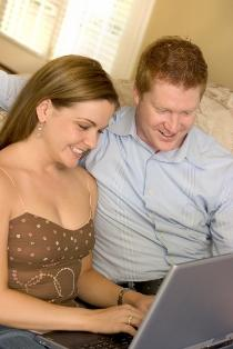 Couple sharing news on their wedding website