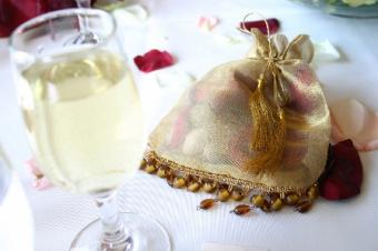 Wedding favor bag and glass of white wine