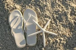 White flip flops for a beach wedding