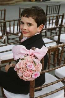 The ring bearer at the wedding reception