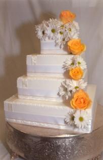 4-tier white wedding cake by Jasmine Bojic