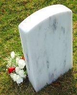 Bridal bouquet left at a grave