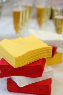Wedding napkins in claret red, yellow and white