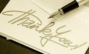 Wedding thank you note and a calligraphy pen