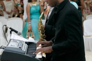 A wedding band playing at a reception