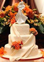Fall theme wedding cake with orange flowers