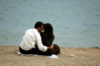 Somali couple sharing romantic moment on the beach