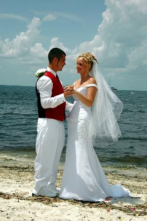 Bride and groom dancing at their beach wedding