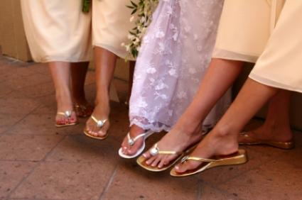 Bride and bridesmaids showing their flip flops