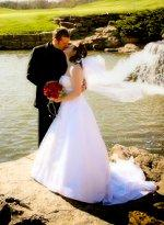 Couple marrying near a beautiful waterfall