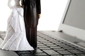 Bride and groom figurines on a laptop