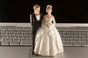 Bridal figurines on a laptop keyboard