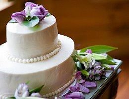 An elegant wedding cake with beads and lavender roses