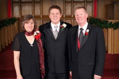 Mother and father standing with the groom