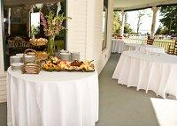 Wedding guest tables set up on the porch