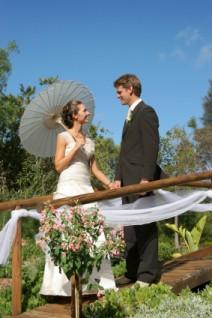 Bridal couple on a bridge decorated with a tulle swag