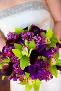A vibrant purple green bridal bouquet