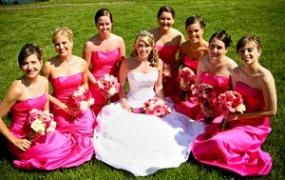 Bride with bridesmaids in bold fuchsia dresses