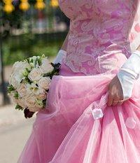 Bride wearing a bold pink wedding dress