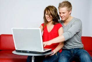Couple filling out a Target wedding registry online