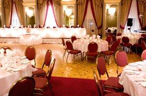 wedding reception setup with rectangular tables