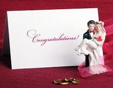 Wedding congratulations card and bridal couple figurine